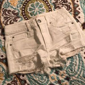 American Eagle Hi Rise Distressed White Shorts
